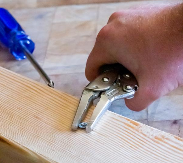 Pull Out The Screw With Pliers