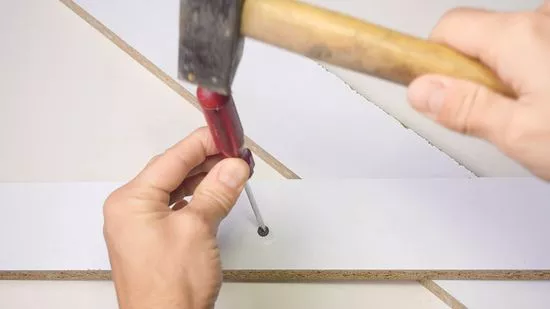 Tap The Screwdriver With A Hammer